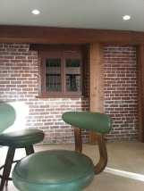 Restored Brick Façade with Antique Windows